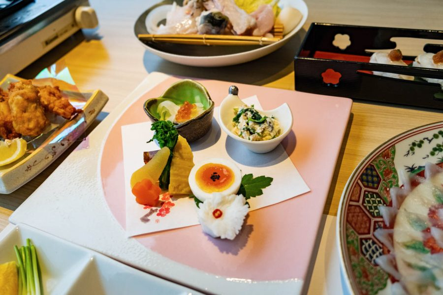 fish eggs and traditional kaiseki Japanese meal with pufferfish