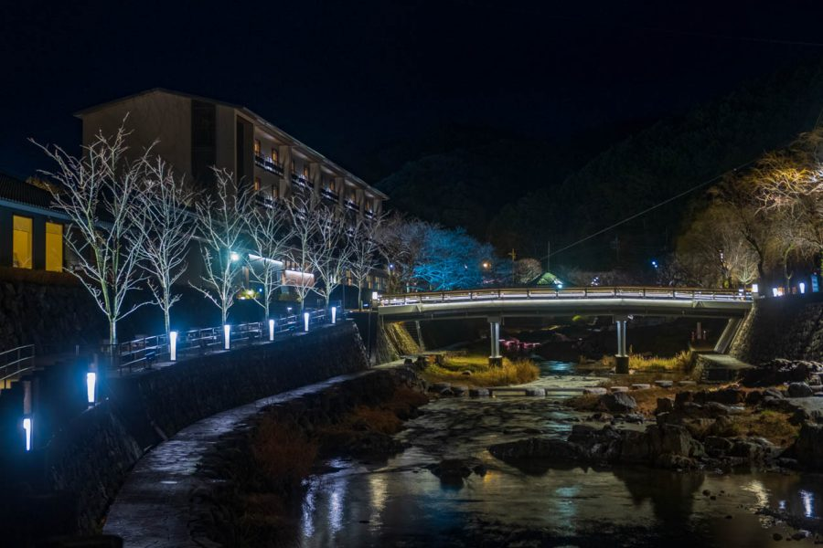 River and night time illuminations in Japanese onsen town