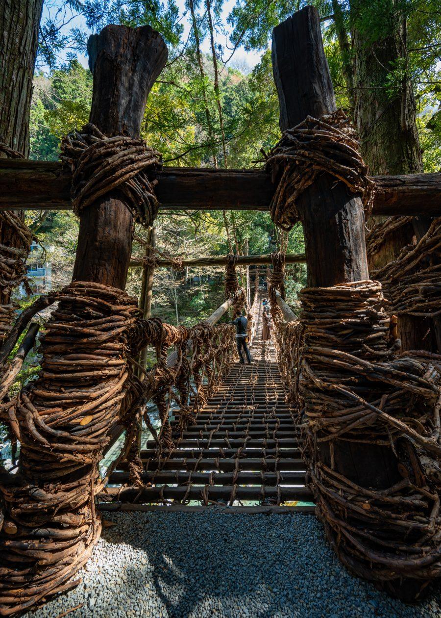 a vine bridge crosses a river in Setouchi