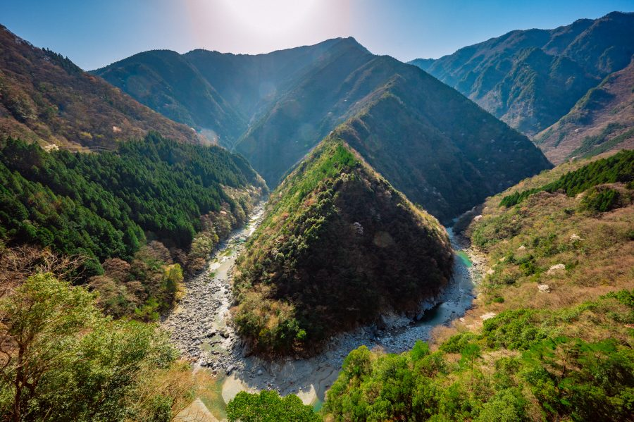 The Iya River cuts a beautiful winding path through the valley, seen from an outlook above.