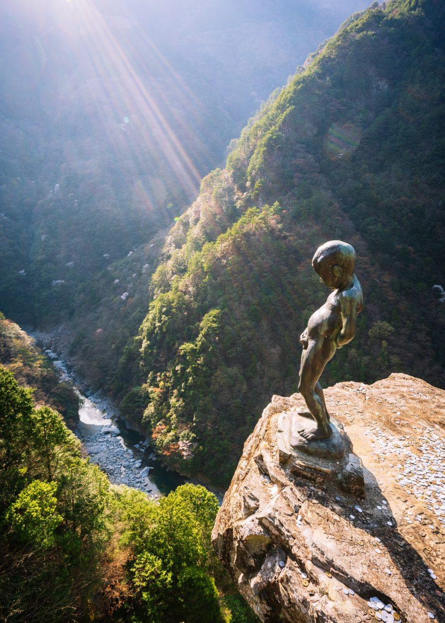 Peeing boy statue overlooks the Iya Valley in Tokushima
