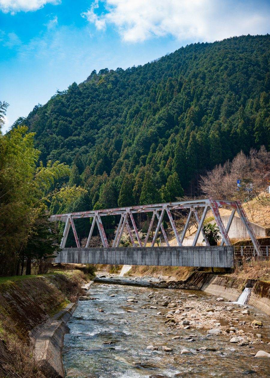 Steel bridge crossing a stream in the mountains of Okayama