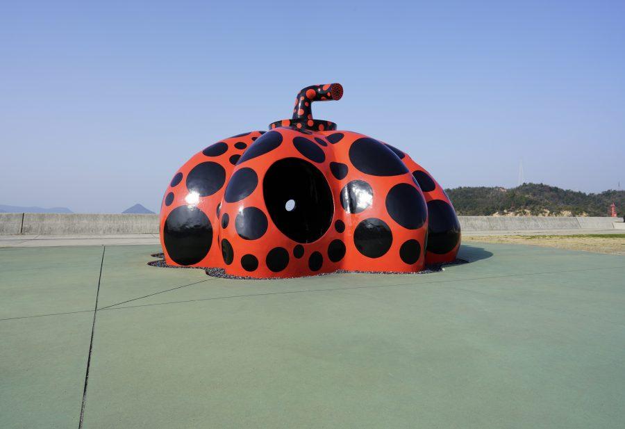 Giant red pumpkin sculpture by Yayoi Kusama on Japanese art island, Naoshima