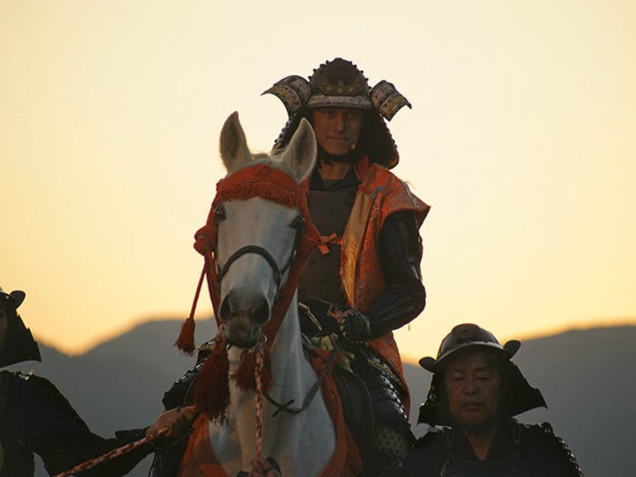 man in samurai warrior armor on horseback in ehime, japan