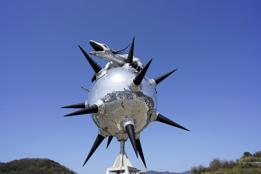 Thousands of tiny mirrors on Star Anger transform this dragon-and-globe sculpture  in Japan